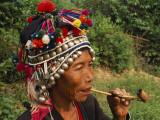 China, Yunnan Province, Xishuangbanna, Elderly Hani Woman Smoking a Pipe Photographic Print by Keren Su