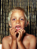 Portrait of a Boy Showing His Teeth Photographic Print