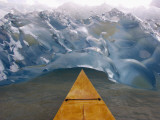 Alaska, Juneau, the Bow of a Mahogany Kayak Noses into an Iceberg Spawned by the Mendenhall Glacier Photographic Print