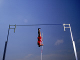 Male Pole Vaulter in Mid-Air Jump, Low Angle View Fotografisk trykk