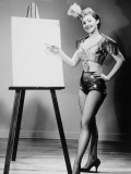 Showgirl Pointing to Piece of Blank Board, 1960S Fotografie-Druck von Lambert 