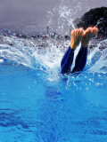 Female Swimmer Diving into Pool Photographic Print