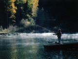Man Fishes from Rowboat Photographic Print by Jeff Foott