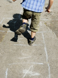 Boy Jumping Hopscotch on School Playground, Copenhagen, Denmark Photographic Print