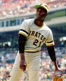 Roberto Clemente 21 of the Pittsburgh Pirates limbers up his arm prior to a game. Photo