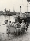Young Girls of the Sophie Germain High School in Paris Getting their Canoe Out of the Water Reproduction photographique