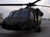 A UH-60 Black Hawk Helicopter on the Flight Line at Dusk in Tikrit, Iraq Photographic Print