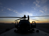 A UH-60 Black Hawk Helicopter on the Flight Line at Sunset Photographic Print
