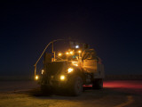 A Maxxpro MRAP Vehicle with Running Lights on at Night Photographic Print