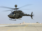 An Oh-58D Kiowa Warrior Hovers over the Flight Line at Camp Speicher, Iraq Photographic Print
