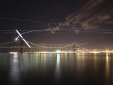 The Path of the Crescent Moon as it Sets over the Ponte 25 De Abril Bridge in Lisbon, Portugal Photographic Print