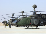 Oh-58D Kiowa Warrior Helicopters Parked at Camp Speicher, Iraq Photographic Print