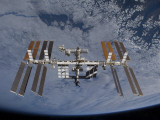 International Space Station Set Against the Background of a Cloud Covered Earth Photographic Print