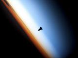 Silhouette of Space Shuttle Endeavour over Earth's Colorful Horizon - Fotografik Baskı