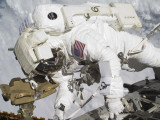An Astronaut Participates in a Session of Extravehicular Activity Photographic Print