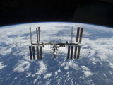 The International Space Station in Orbit Above the Earth Photographic Print