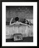 Actor Steve McQueen and Wife Taking Sulfur Bath at Home Framed Photographic Print by John Dominis