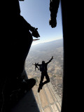 US Air Force Academy Parachute Team Jumps Out of an Aircraft over Nellis Air Force Base, Nevada Photographic Print