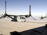A Mv-22 Osprey Refuels Midflight While Another Waits its Turn Photographic Print