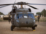 A UH-60L Black Hawk with Twin M240G Machine Guns at the Victory Base Complex in Baghdad, Iraq Photographic Print