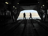 C-17A Globemaster Iii Loadmasters Go Through Prefight Checks on the Ramp Photographic Print