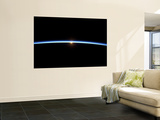 The Thin Line of Earth's Atmosphere and the Setting Sun Wall Mural