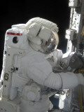 An Astronaut Performs a Task on the Exterior of the International Space Station Photographic Print