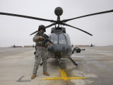 An Oh-58D Kiowa Warrior Pilot Stands Beside His Aircraft Photographic Print