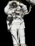 Astronaut Anchored to a Mobile Foot Restraint Participates in a Session of Extravehicular Activity Photographic Print