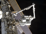 The Canadarm2 Mates the Express Logistics Carrier to the Outboard Payload Attachment System Photographic Print