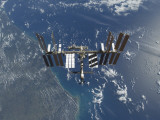 International Space Station in Orbit Above the Earth Photographic Print