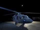 A UH-60 Black Hawk Helicopter Parked on the Flight Line under a Full Moon Photographic Print