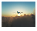 A Plane In Flight Over Clouds Photographic Print by Chris Harvey