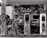 Hippie Gas Station, 1971 Prints by Dennis Stock