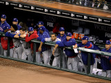 Texas Rangers v San Francisco Giants, Game 1: The Texas Rangers look on from the dugout Photographic Print by Christian Petersen