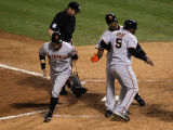 Texas Rangers v. San Francisco Giants, Game 5:  (L-R) Cody Ross, Edgar Renteria and Juan Uribe Photographic Print by Stephen Dunn