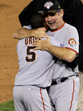 Texas Rangers v. San Francisco Giants, Game 5:  Manager Bruce Bochy celebrates with Juan Uribe Photographic Print by Stephen Dunn