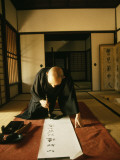 A Zen Abbot Practices Calligraphy in the Daitokuji Temple Photographic Print by Thomas J. Abercrombie