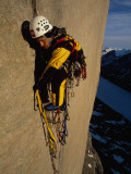 A Climber Balances in Slings on the Upper Wall of Great Sail Peak Photographic Print by Gordon Wiltsie