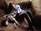 A Young Girl Sleeping in the Hay with Her Pet Dalmatian Photographic Print by Annie Griffiths