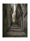 A Muslim Woman Walking Down a Steep Stairway Lámina fotográfica por Courtellemont, Gervais