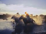 Argentine Gauchos Race across a Lake Near Beron De Astrada Fotografisk tryk af O. Louis Mazzatenta