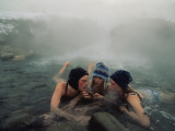 High School Friends Enjoy a Thermal Spring Near Gardiner, Montana Photographic Print by Annie Griffiths
