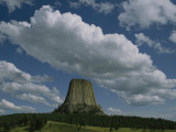 Puffy Clouds Fill the Sky over Devil's Tower Photographic Print by Randy Olson