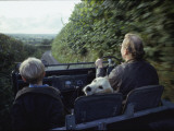 A Man and His Son and Dog Drive Down a Country Road Near their Home Fotografisk tryk af Sam Abell