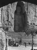 The Great Buddha Statue Carved into a Cliff at Bamian Photographic Print by Maynard Owen Williams