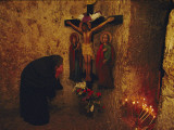 A Greek Pilgrim Prays in the Grotto Where Jesus Was Sentenced to Die Photographic Print by Annie Griffiths