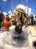A Scientist Uses a Submersible Suit to Search a Shipwreck Photographic Print by Emory Kristof