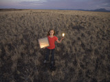 A Young Girl Experiments with Solar Energy Photographic Print by John Burcham