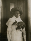 A Stylish Young Kenyan Woman Holding Her Pet Deer Photographic Print by  Underwood & Underwood
